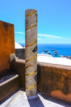 Striking mosaic column overlooking Spiagia Grande. by Mr JT